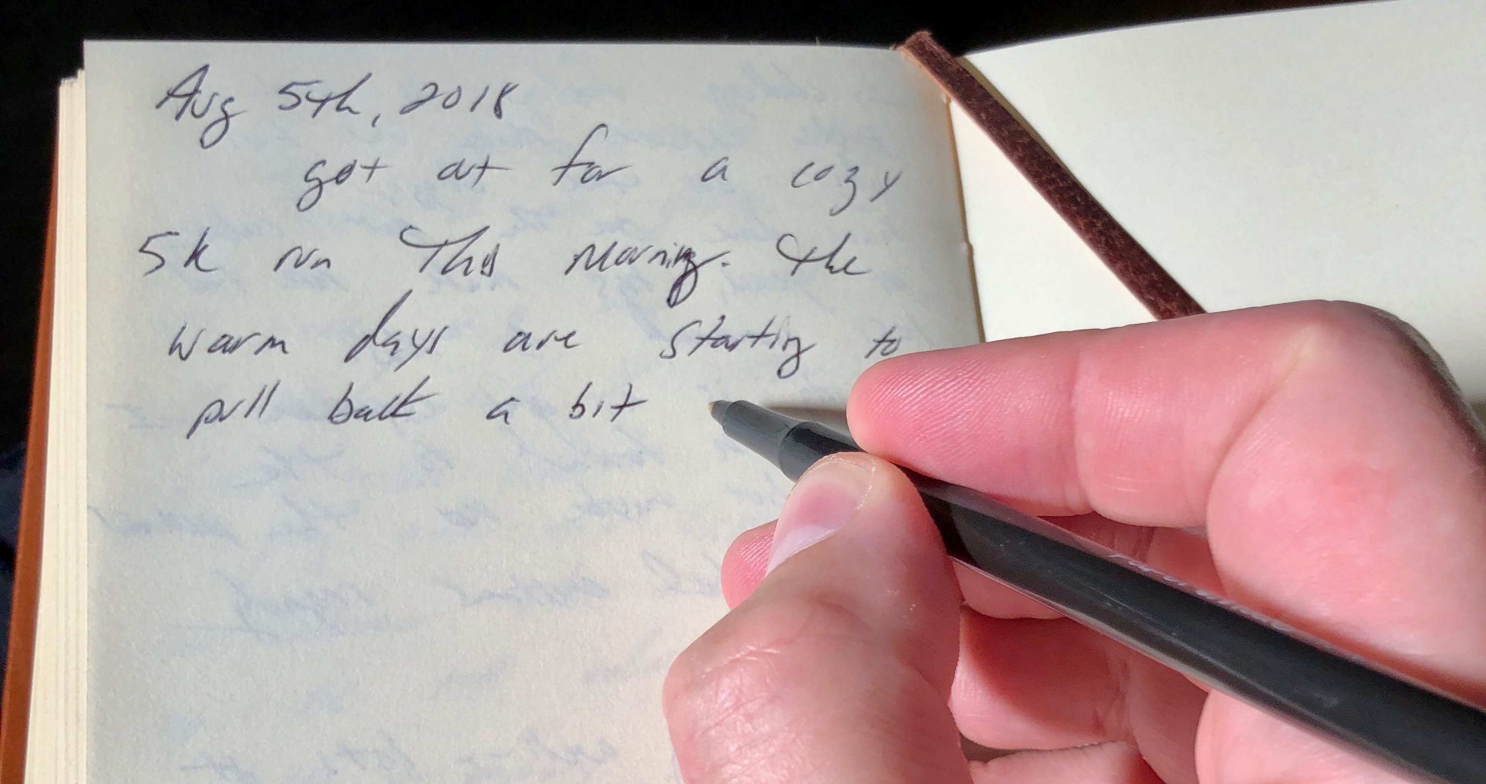 Keeping a journal pen and paper