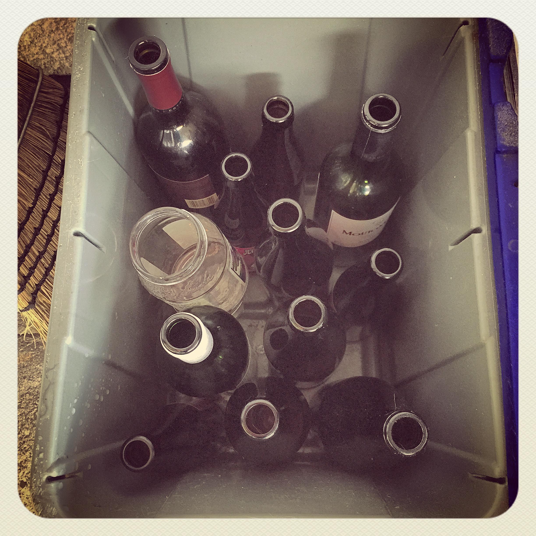 Booze bottles in the glass bin